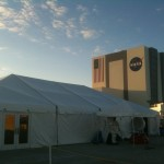 Nasa TweetUp Tent with VAB in background lit by the sunset